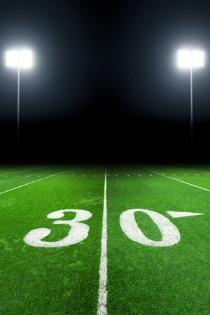 green field: American football field at night with stadium lights Stock Photo