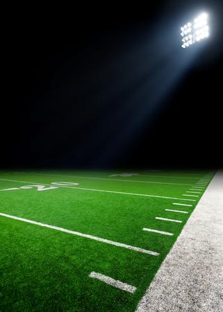 american football ball: Football field illuminated by stadium lights