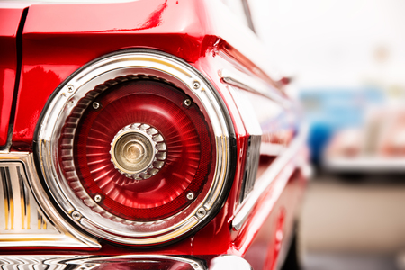 Photograph of classic car with close-up on taillights
