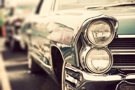 Classic car with close-up on headlights Standard-Bild