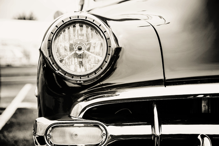 Photograph of a classic vehicle with close-up on headlights.
