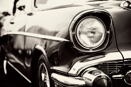 old technology: Classic car with close-up on headlights Stock Photo