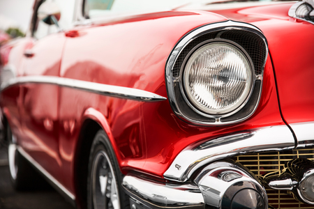 Classic car with close-up on headlights 스톡 콘텐츠