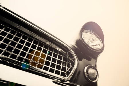 old car: Classic car headlights in sun flare