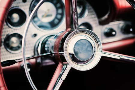 Classic car with close-up on steering wheel 스톡 콘텐츠