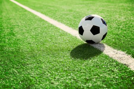 Soccer ball on soccer field Foto de archivo