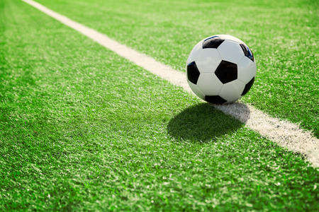 Soccer ball on soccer field Stock Photo