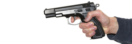 Mans hand holding gun isolated on white background Stock Photo