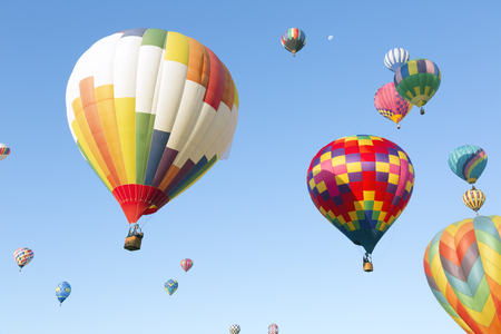 Multi colored hot air balloons on blue sky Stockfoto - 123051270
