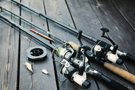 Fishing rods and accessories on wooden  with text space Stok Fotoğraf