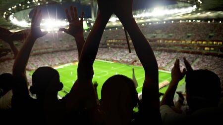 Soccer stadium full of fans cheering after goal