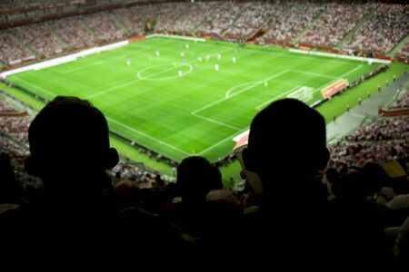 Soccer stadium with people watching game in progress Stok Fotoğraf