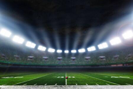 Estadio de fútbol americano con luces.