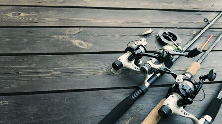 Fishing rods and accessories on wooden Stok Fotoğraf