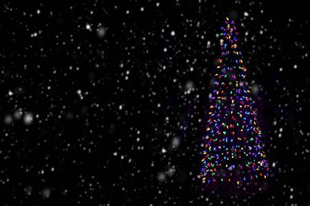 Christmas tree with snowflakes on dark background Stok Fotoğraf