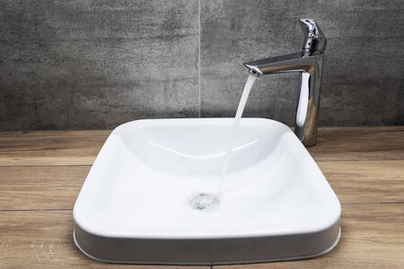faucet with running water in bathroom