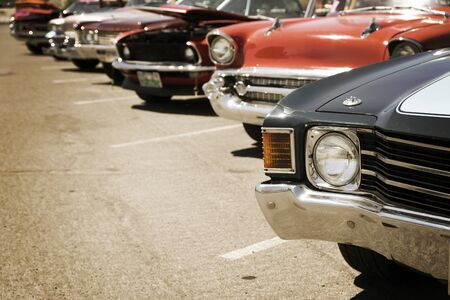 Classic cars parked in a row on the street