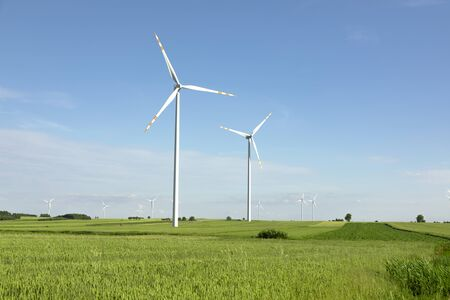 wind turbines in green field, countryside area with blue sky Reklamní fotografie - 142537670
