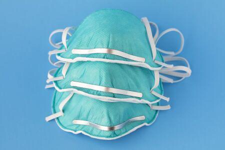 medical masks to protect against flu, virus on blue background, coronavirus concept