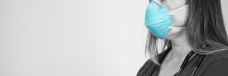 Nurse wearing respiratory face mask to protect against coronavirus, virus epidemic concept Reklamní fotografie