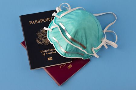 passports and flu, virus masks to protect against coronavirus, global epidemic concept