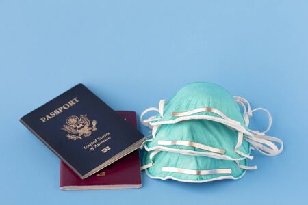 passports and flu, virus masks to protect against coronavirus, global epidemic concept