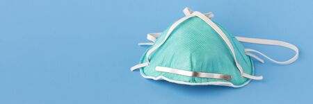 medical masks to protect against flu, virus on blue background, coronavirus concept