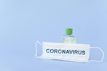 medical mask to protect against covid-19 flu with gel hand sanitizer, coronavirus concept