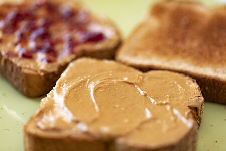Toasted whole wheat bread slices with peanut butter and jam Reklamní fotografie
