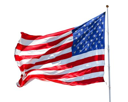 American flag waving in the wind isolated on white background, US flag motion close-up, red white blue flag outdoors in sunlight. United States of America national flag. USA stars and stripes