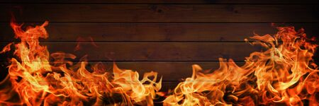 Fire flames on wooden background, barbecue grill copy space
