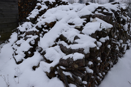 Snow on the wood pile