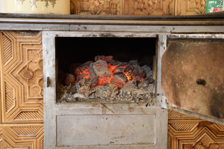 Hot Coals in the old old stove Stock Photo
