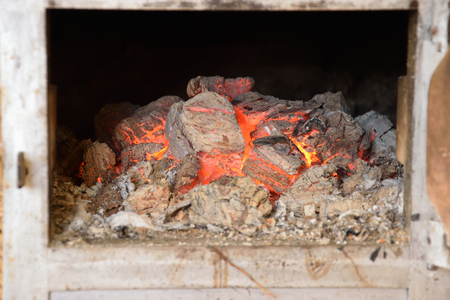 Hot Coals in the old old stove Stock Photo - 72285043