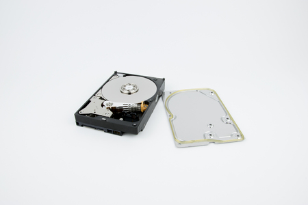 Disassembled PC Hard Drive HDD on the white background with platters and head stack visible