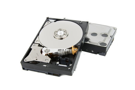 ide: Disassembled PC Hard Drive HDD on the white background with platters and head stack visible