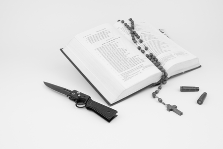 Bible with a rosary, a knife and the bullet cartridges
