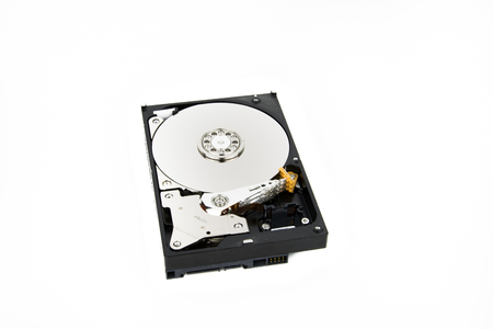 Disassembled PC Hard Drive HDD on the white background with platters and head stack visible Stock Photo - 74088230