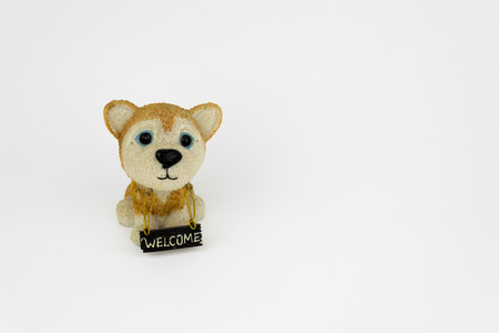 Porcelain Dog with Welcome Sign Stock Photo