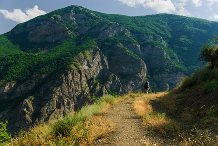 Backpacker hiking in the majestic Armenian mountains in the summer, Tatev, Armenia