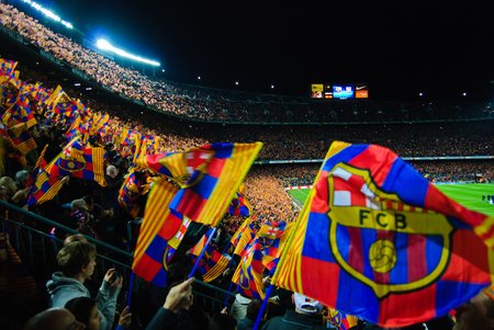 FC Barcelona football match against Atletico Madrid - match details with flags and fans at Camp Nou