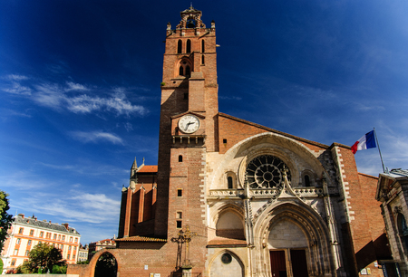 Cathedral of Saint Stephen - gothic art with French flag, Toulouse, France