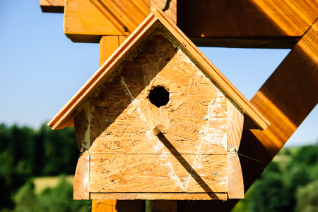 Wooden handmade birdhouse in the Polish countryside