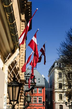 Latvian national flags in Riga old town, Riga, Latvia Stok Fotoğraf