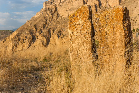 Khachkar - traditional Armenian cross-stone in the mountains near Areni village, Southern Armenia, Caucasus region and mountains