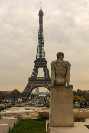Eiffel Tower and The Man - LHomme statue in Jardins de Trocadero during sunset in autumn, Paris, France