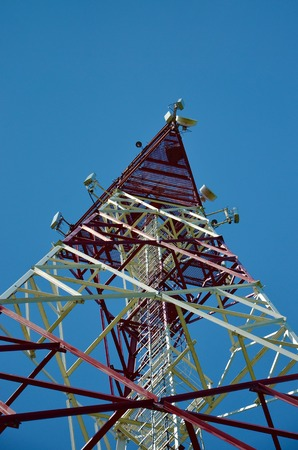 Mobile phone cellular telecommunication radio antenna tower. Cell phone tower against blue sky 1