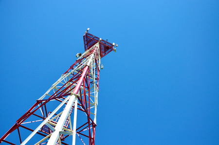 Mobile phone cellular telecommunication radio antenna tower. Cell phone tower against blue sky Stock Photo