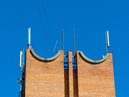 Cell phone antenna, transmitter. Telecom radio mobile antenna against blue sky 1