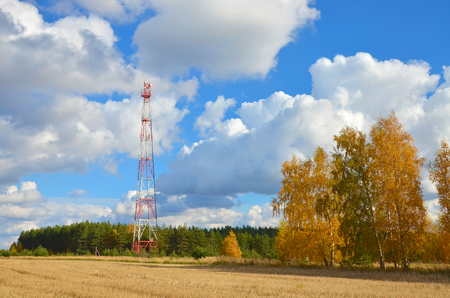 Mobile phone cellular telecommunication radio tv antenna tower against blue sky